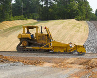 Crush & Pack road machine. Heavy equipment building road base for new highway Stock Photo