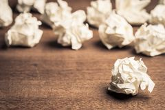 Crush Paper Balls. Many crush paper balls on wood table royalty free stock photography