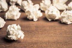 Crush Paper Balls. Many crush paper balls on wood table royalty free stock photo