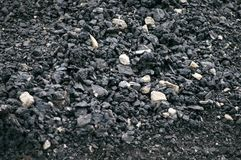 Asphalt with a large fraction of black with crushed stone close-up, macro royalty free stock photo