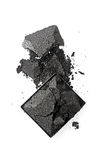 Crushed black eyeshadow as sample of cosmetic product. Isolated on white background royalty free stock photography