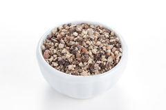 Crushed Black pepper in a bowl on white background Stock Images