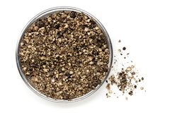Crushed Black Peppercorns Top View Isolated. Crushed black peppercorns, top view, isolated on white stock images