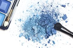 Crushed blue eyeshadow with makeup brush Royalty Free Stock Images