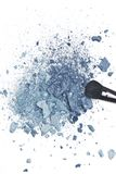 Crushed blue eyeshadow with makeup brush Royalty Free Stock Image