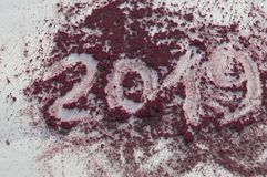 Crushed blush and powder in fashionable bright colors on white background. The inscription 2019.  stock photos