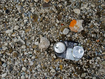 Crushed can. A single crushed beer can on a stone floor royalty free stock images