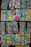Crushed Cans for Recycling. Packs of crushed cans packaged together for recycling by melting down Royalty Free Stock Photos