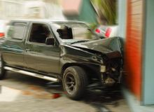 Crushed car. Road traffic accident . The modern car is crushed in the high speed collision with the wall of building Stock Photography