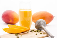 Crushed Cardamon, Pestle, Mangos And Mango Lassie Stock Photos