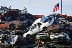 Crushed Cars and American Flag Royalty Free Stock Photo