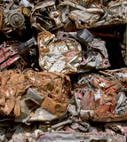 Crushed cars closeup. Unusual closeup of crushed, mangled cars in a wrecking yard royalty free stock images