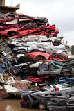 Crushed cars. Going to be shredded in a recycling facility stock photos