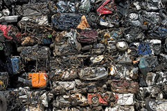 Crushed cars stacked. A stack of crushed cars for metal recycling royalty free stock image