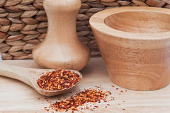 Crushed Chillies in rustic kitchen scene. Crushed chillies on wooden spoon in rustic kitchen setting Stock Photos