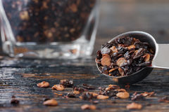 Crushed chipotle peppers. Spilled from a measuring spoon royalty free stock photo
