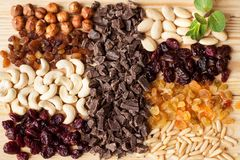 Assorted nuts, dried berries, chocolate stock photo
