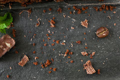 Crushed chocolate shavings on black background Stock Photos