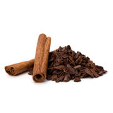 Crushed chocolate shavings pile and cinnamon sticks. Isolated on white background Stock Photography