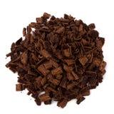 Crushed chocolate shavings pile. Isolated on white background Royalty Free Stock Image