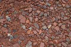 Crushed clay with an admixture of other crushed stones. Picture of crushed clay, made of crushed bricks and roofing tiles, with an admixture of other crushed Stock Image
