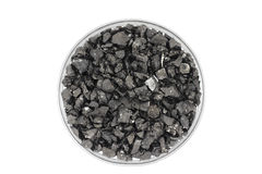 Crushed coal in a glass Royalty Free Stock Photography