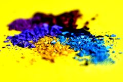 Crushed colorful makeup pigments stock photography