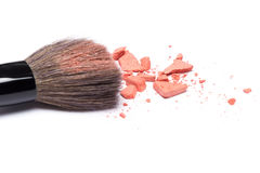 Crushed compact blush apricot color with makeup brush Royalty Free Stock Photo