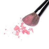 Crushed compact blush pink color with makeup brush Stock Photo