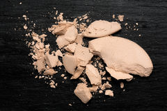Crushed Compact Powder on Blackboard Stock Image