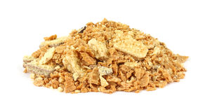 Crushed cookies. A pile of crushed cookies on a white background royalty free stock photo