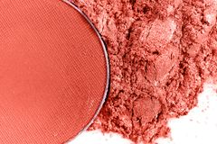 Crushed coral eye shadow on white background stock photography