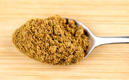 Crushed cumin powder in teaspoon Stock Photos