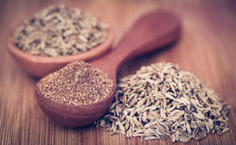 Crushed cumin with whole. Closeup of crushed cumin with whole ones Stock Image