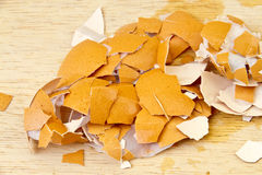Crushed egg shells shattered on the wooden floor stock image