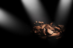 Crushed eye shadow braun color isolated on black background with spot light.  Stock Images