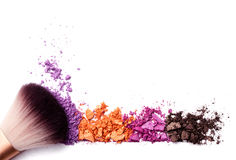 Crushed eye shadows and brush isolated. On white royalty free stock photography