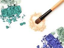 Crushed eyeshadow with brush  on white. Royalty Free Stock Image