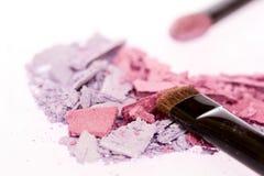 Crushed eyeshadow close up. Crushed eyeshadow isolated on white (selected focus Royalty Free Stock Photo