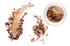Crushed eyeshadow isolated on white background. Crushed eyeshadow brown isolated on white background Stock Images
