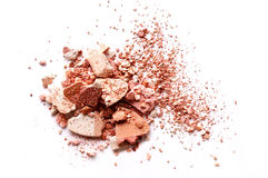 Crushed eyeshadow isolated on white background. Crushed eyeshadow brown isolated on white background Royalty Free Stock Images