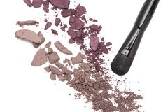 Crushed eyeshadow with makeup brush royalty free stock photography
