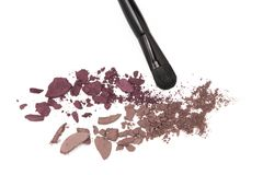 Crushed eyeshadow with makeup brush Royalty Free Stock Photo