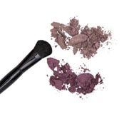 Crushed eyeshadow with makeup brush Stock Photo
