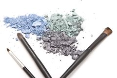 Crushed eyeshadow with makeup brushes Stock Images