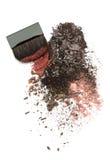 Crushed eyeshadow mix and brush Royalty Free Stock Photo