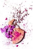 Crushed eyeshadow palette and powder close-up isolated on white background. Beauty texture, cosmetic product and art of make-up concept - Crushed eyeshadow royalty free stock photo