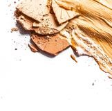 Crushed eyeshadow, powder and liquid foundation close-up  on white background. Beauty texture, cosmetic product and art of make-up concept - Crushed eyeshadow royalty free stock images
