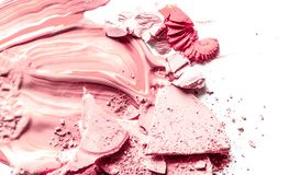 Crushed eyeshadow, powder and liquid foundation close-up isolated on white background. Beauty texture, cosmetic product and art of make-up concept - Crushed stock images