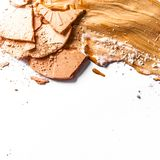 Crushed eyeshadow, powder and liquid foundation close-up isolated on white background. Beauty texture, cosmetic product and art of make-up concept - Crushed royalty free stock photo